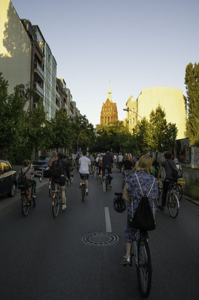 a group of people riding bikes down a street