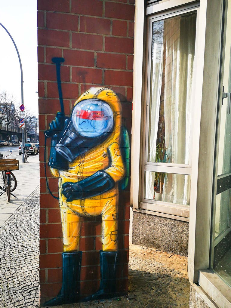 Blue Indian by Cranio in an enviromental protection suit in Schoeneberg's Buelowstrasse