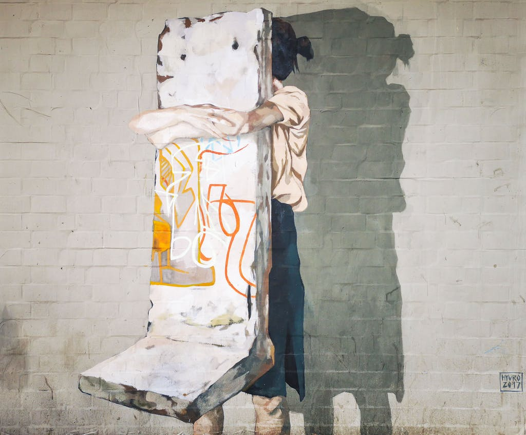 Powerful piece showing a kid hugging the Berlin Wall by enigmatic Spanish artist Hyuro - or maybe she's carrying it away, who know?