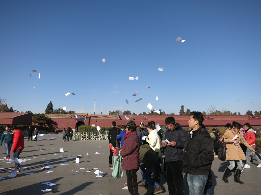 Pamphlet distribution at Tiananmen Square (CC BY 2.0: edward stojakovic from Portland, OR, United States)