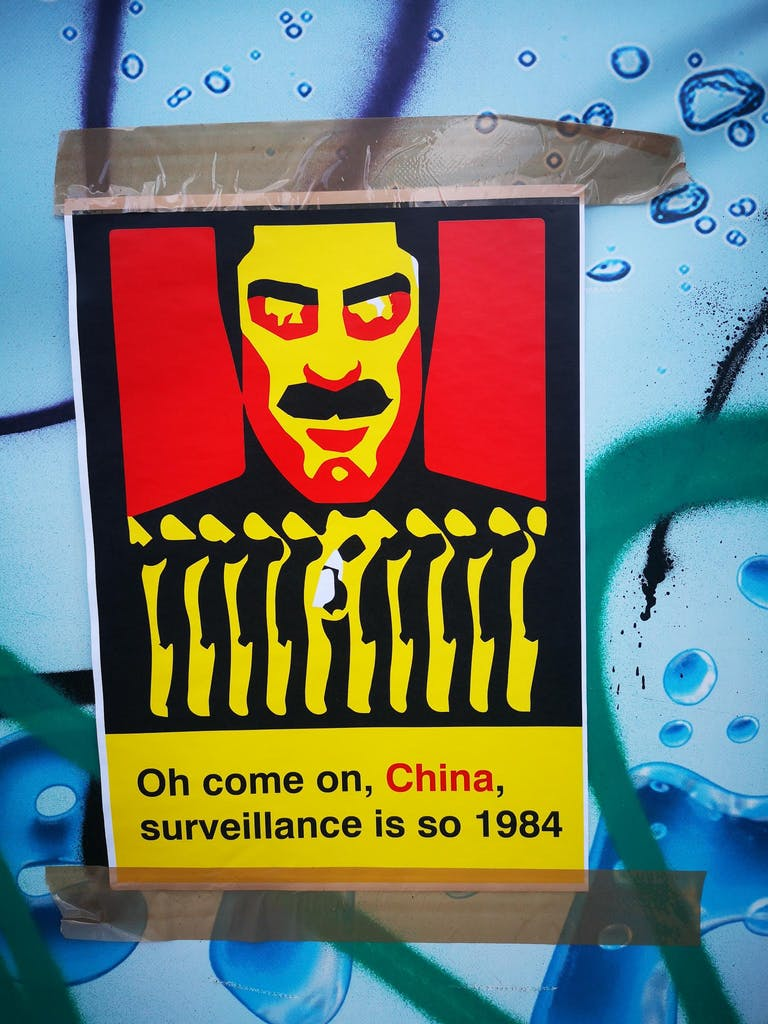 political poster on a construction site in Berlin Prenzlauer Berg sayying: Oh come on, China, surveillance is so 1984