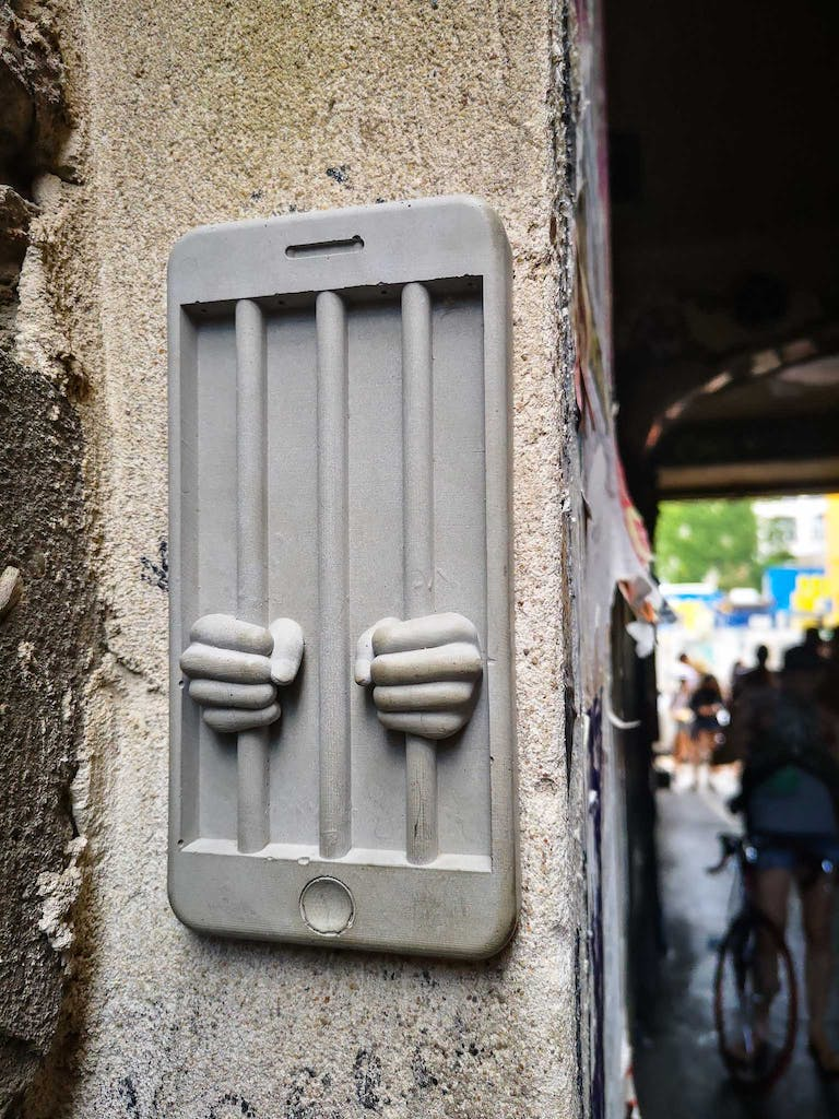 A telephone shaped prison made out of resin. 3D street art in Haus Schwarzenberg