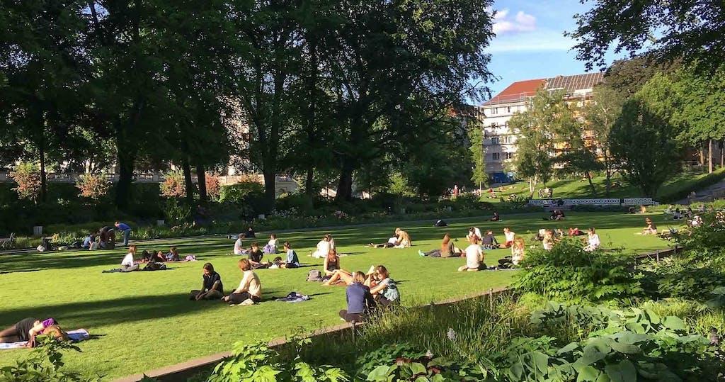 Locals chilling in the sub-street level Körnerpark in Neukölln