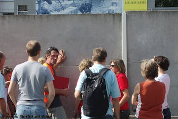 a group of people standing in front of a building