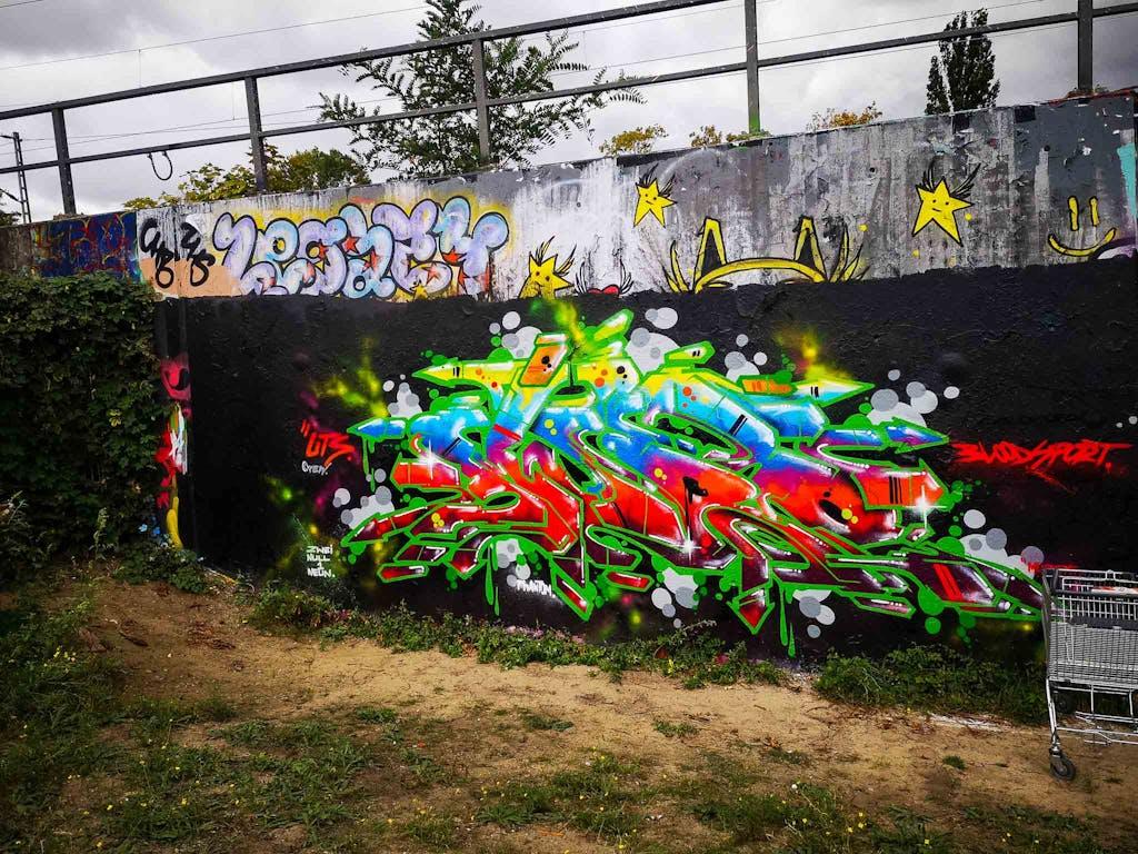 a row of colorful graffiti