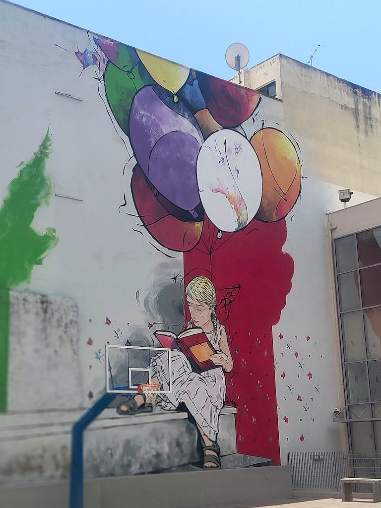 Another reading girl in Athens. Maybe this is a subtle hint to Banksy's famous girl with a ballon?