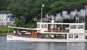 a steam boat on the water