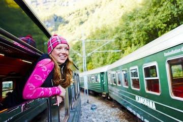 a girl sitting on a train
