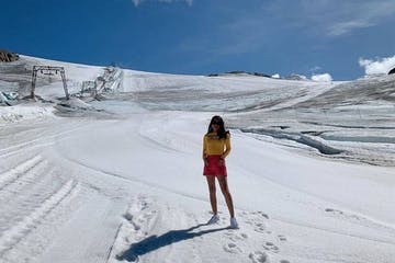 a person walking across a snow covered slope