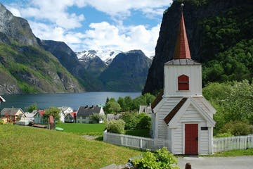 a church with a mountain in the background