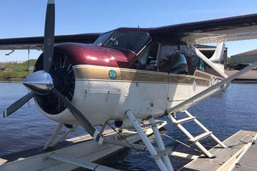a small plane sitting on top of a boat
