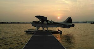 a airplane that is sitting next to a body of water