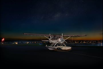 a airplane that is sitting on a tarmac at night