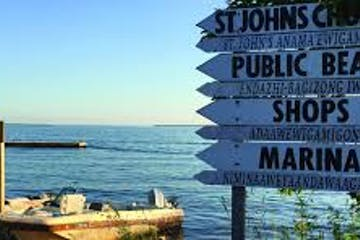 a sign in front of water
