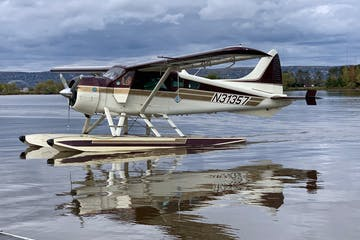 a airplane that is parked next to a body of water