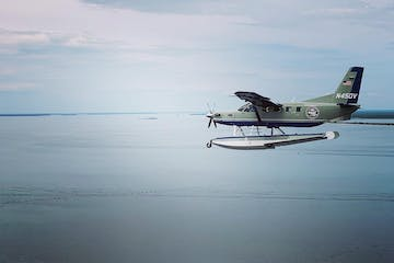 a plane flying over a body of water