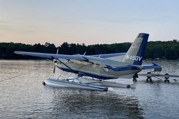 a plane sitting on top of a body of water