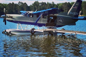 a airplane that is swimming in the water
