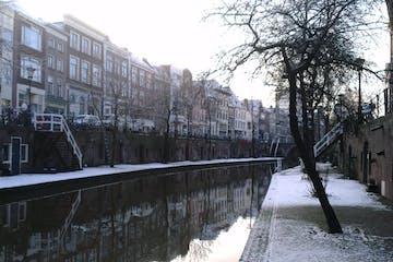 a bridge over a river in the snow