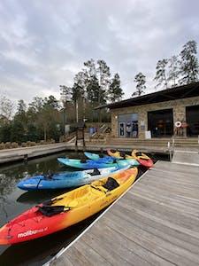 tandem kayaks floating in the water