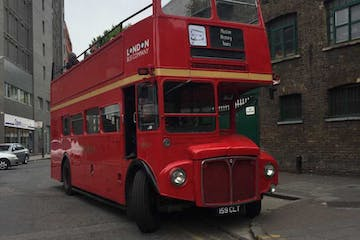 a double decker bus parked on the side of a building