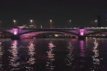 a bridge over a body of water at night