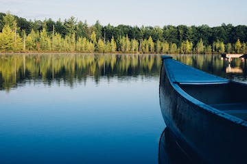 a boat on a lake next to a body of water