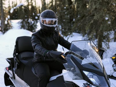 a man riding a motorcycle in the snow