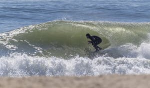a person riding a wave on a surfboard in the ocean