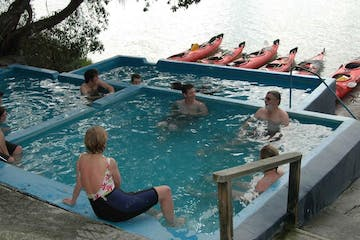 a group of people sitting in a swimming pool