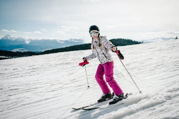 a person riding skis down a snow covered slope