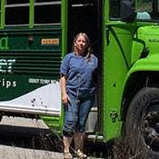 a person standing next to a bus