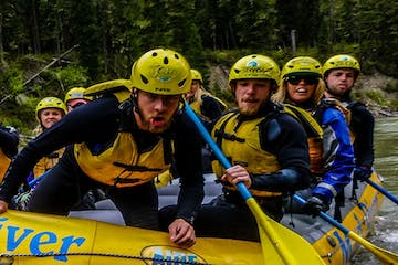 a group of people riding on a raft