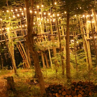 The ropes course all lit-up at night.