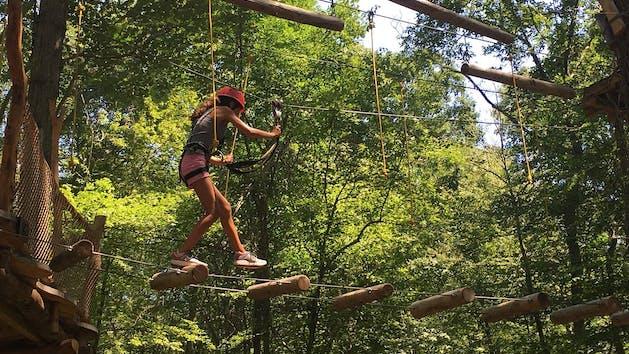 A climber navigating the aerial course.