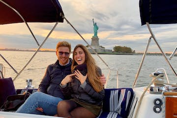 boat proposal NYC during a romantic boat cruise by the Statue of Liberty