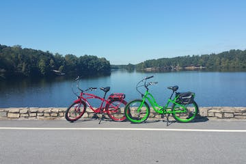a bicycle parked in front of a body of water