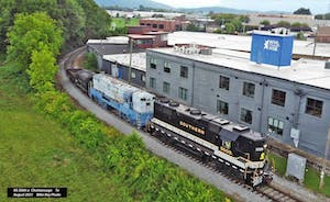 a train is parked on the side of a building