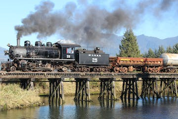 a steam engine train with smoke coming out of the water
