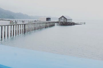 a close up of a pier next to a body of water