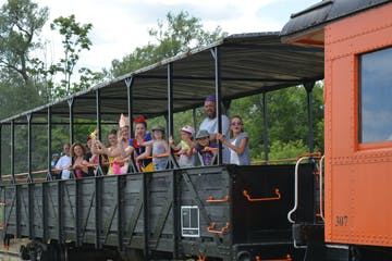a group of people riding on the back of a train