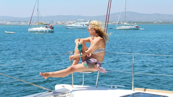 a person riding on the back of a boat in a body of water