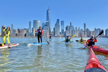 kayakers and SUPers in the winter on the Hudson River near Manhattan