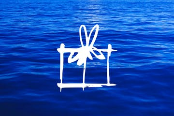 a blue chair next to a body of water