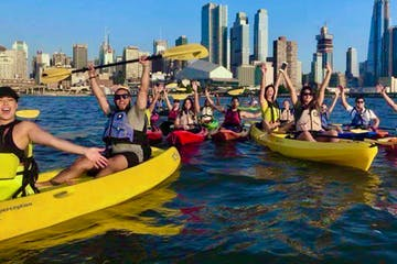 a group of people riding kayaks in the Hudson River in NYC