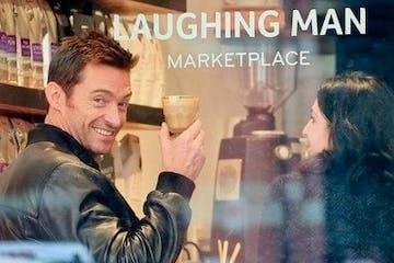 Hugh Jackman holding a glass