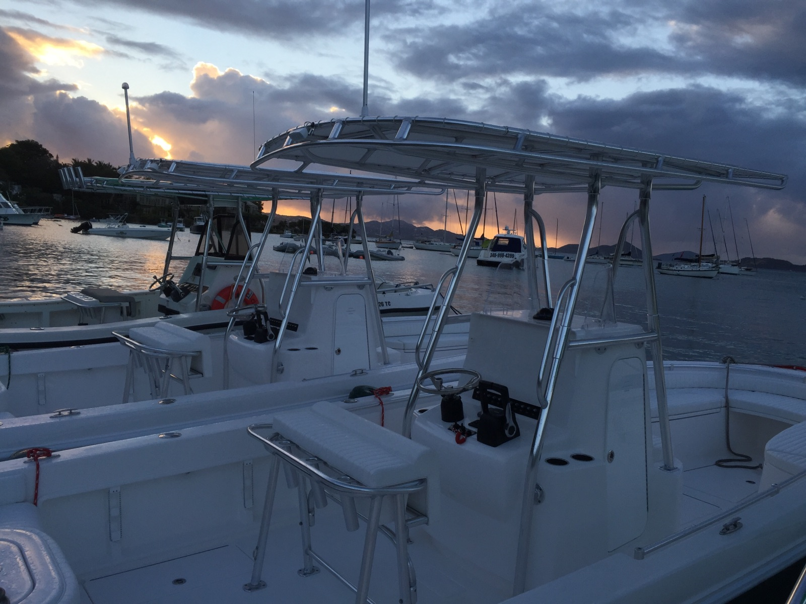 This is a photo of our newest Contender powerboats at sunset rafted up in Cruz Bay