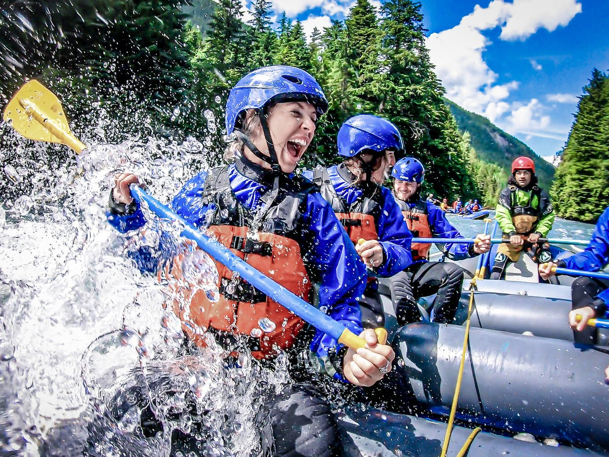 Fun woman white water rafts