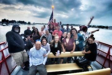 Salima Ikram et al. standing in front of a boat