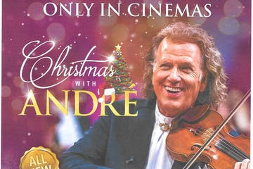 Andre Rieu holding a book
